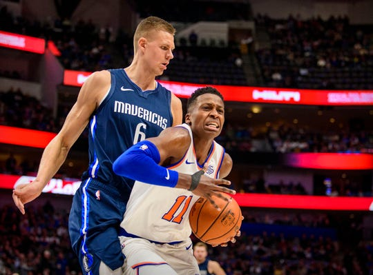Dallas Mavericks forward Kristaps Porzingis (6) and New York Knicks center Bobby Portis (1) fight for the rebound during the first quarter at the American Airlines Center.
