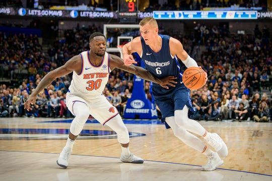 Mavericks forward Kristaps Porzingis (6) drives to the basket past New York Knicks forward Julius Randle (30) during the second quarter at the American Airlines Center.