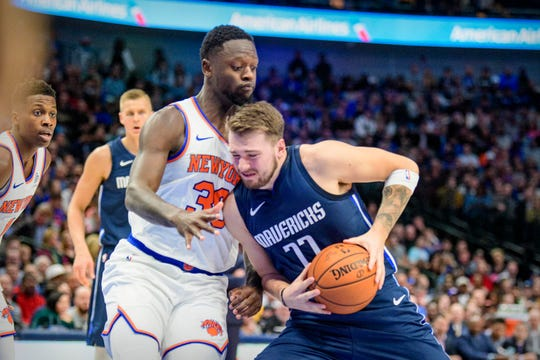 New York Knicks forward Julius Randle (30) defends against Dallas Mavericks guard Luka Doncic (77) during the second quarter at the American Airlines Center.