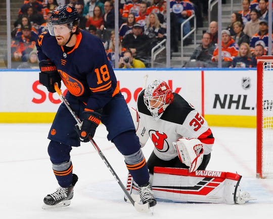 Edmonton Oilers forward James Neal (18) tries to screen New Jersey Devils goaltender Cory Schneider (35) during the first period at Rogers Place.
