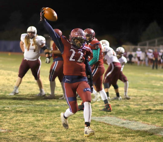 Senior Wildcat running back Ceazer Chavez (22) visited the end zone three times in Deming's 42-6 playoff victory over the visiting Belen High Eagles Friday at DHS Memoral Stadium.