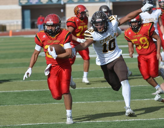 Gabriel Acosta breaks away for a Centennial touchdown on Saturday afternoon as the Hawks took on the Cibola Cougars in the first round of the state football playoffs at Field of Dreams.