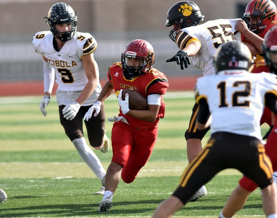 Centennial's Gabriel Acosta breaks through the Cibola High defense during Saturday's playoff game at Field of Dreams.