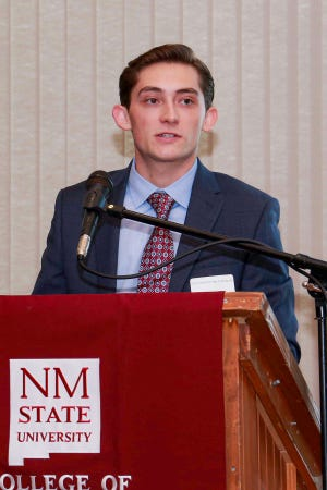 Caleb Gattis, a business student at New Mexico State University, speaks at the College of Business's annual scholarship luncheon Oct. 4 at the New Mexico Farm and Ranch Heritage Museum in Las Cruces. Gattis is one of an estimated 185 business students who have received scholarships for the 2019-2020 academic year.