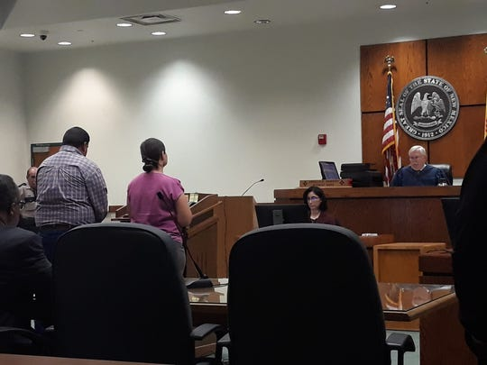 Gregory Saavedra, in blue, appears in Third Judicial District Court for sentencing on Friday, Nov. 8, 2019.