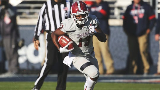 New Mexico State wide receiver Tony Nicholson turns upfield against Mississippi on Saturday.