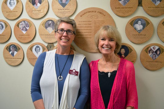 Karen Hand, a former nursing professor at New Mexico State University, right, stands next to Alexa Doig, the director of the School of Nursing, after the unveiling of Hand's plaque on the Nursing Wall of Excellence in honor of her 45-year career and commitment to the nursing profession.
