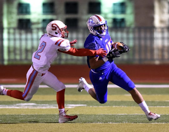 Las Cruces High's William Magee runs back a kickoff return for a long gain against the Sandia Matadors during Friday night's playoff game against the Sandia Matadors.  Photo taken 11/8/19.