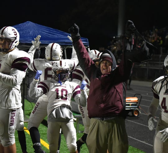 The Maples' bench celebrates yet another touchdown by Seaholm. Birmingham Seaholm ended up beating Groves 42-7.