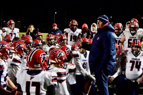 Franklin coach Chris Kelbert talks to his team after losing to King in the 2019 playoffs. The team's success in recent years is tied, in part, to updating Franklin's offensive schemes.