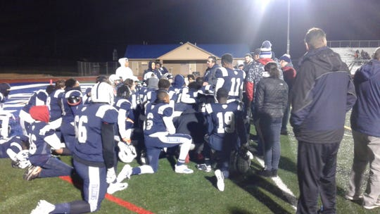 Farmington head coach Kory Cioroch addresses his team after losing to U-D Jesuit in the district final.