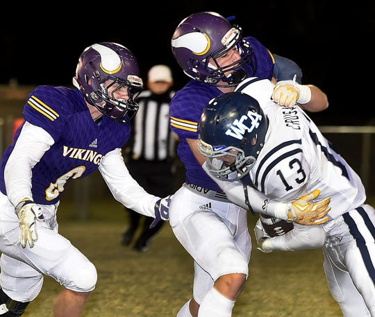 Westminster Christian Academy running back Landon Devillier fights for yardage against Opelousas Catholic on Friday night. Devillier gained 91 yards in the game, giving him more than 1,000 rushing yards for the 10-game regular season.