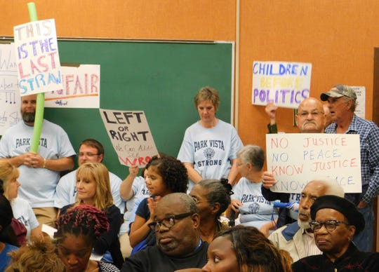 Protesters attend St. Landry Parish School Board meeting.