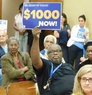 Protesters attend St. Landry Parish School Board meeting to show support for larger educator bonuses this year.