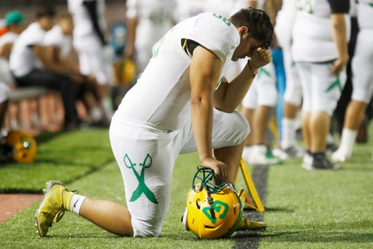 Coachella Valley High School's Julio Sanchez reflects during the second half of their game against Jurupa Hills High School as they are down 2 touchdowns in their CIF playoff game on November 8, 2019.