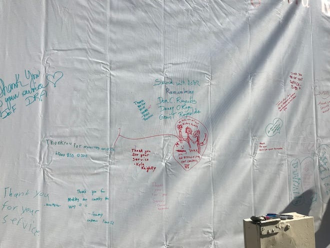 Visitors wrote thank-you messages to veterans on a large canvas at Patriot Park.
