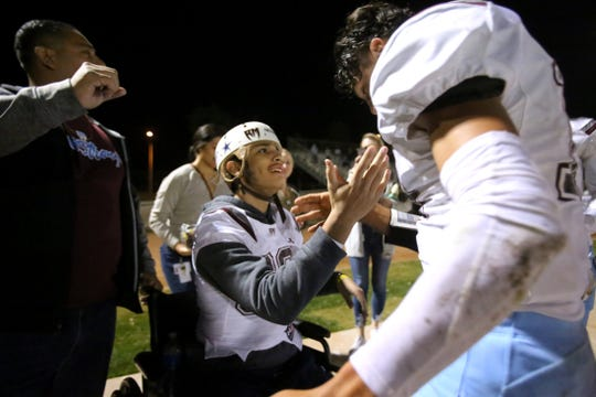 Cesar Vela greets Izzy Ramirez on the sidelines of the CIF football playoffs at Norte Vista High School in Riverside, Calif., on November 8, 2019.
