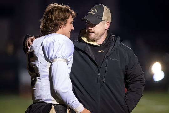 Delone Catholic head coach Corey Zortman and senior quarterback Kevin Mowrey talk together following the the District III Class 2A championship game against Upper Dauphin in Elizabethville on Friday, Nov. 8, 2019. The Squires fell 36-28.