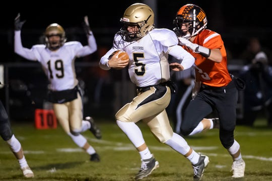 Delone Catholic quarterback Kevin Mowrey takes off on a 30-yard run to score a touchdown and put the Squires up 6-0 in the first quarter of the District III Class 2A championship game Friday. Mowrey finished 13-of-23 for 222 yards with two touchdowns and an interception.