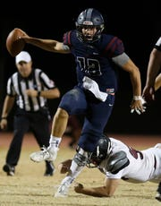 Perry's Chubba Purdy (12) dances away from a Mountain Ridge defender during the second half of their game in Gilbert, Friday, Nov. 8, 2019.