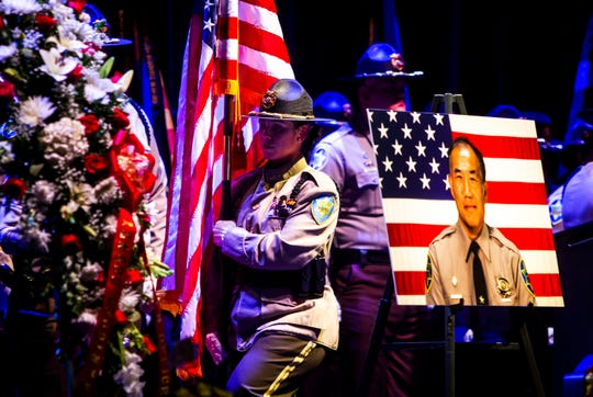 "MCSO officers march with a flag in respect of fallen detention Officer Gene ""Jim"" Lee during the public celebration of life service for Maricopa County Sheriff's Office Officer Gene ""Jim"" Lee, who was fatally attacked by an inmate at Lower Buckeye Jail, at Comerica Theater on Friday, Nov. 8, 2019."