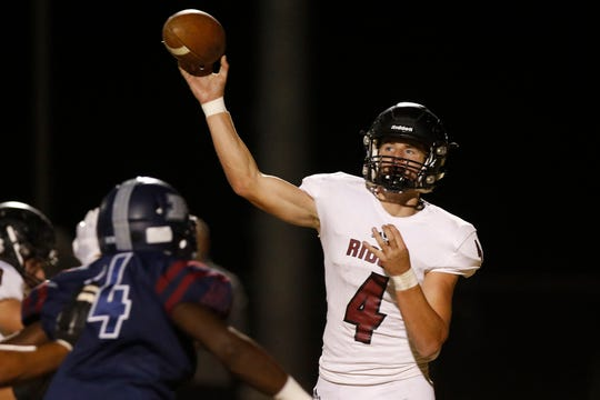 Mountain Ridge's Keegan Stancato (4) throws against Perry during the first half of their game in Gilbert, Friday, Nov. 8, 2019.