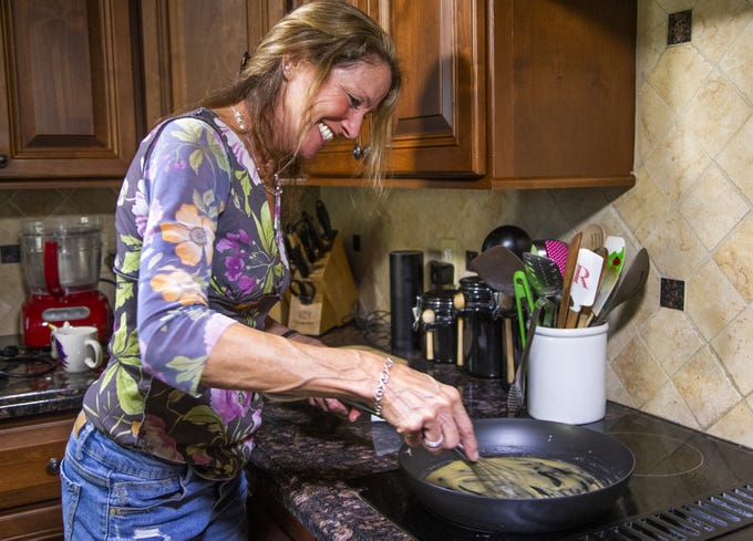 Chef and author Robin Miller stirs butter and flour roux in a pan on the stovetop.