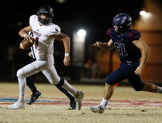 Mountain Ridge's Keegan Stancato (4) runs away from  Perry's Adam Knowles (61) during the first half of their game in Gilbert, Friday, Nov. 8, 2019.