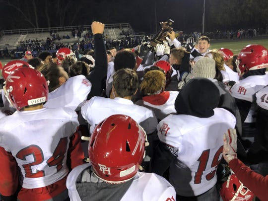 The Port Huron football team celebrates its district championship win over St. Clair Shores Lakeview on Friday, Nov. 8, 2019.