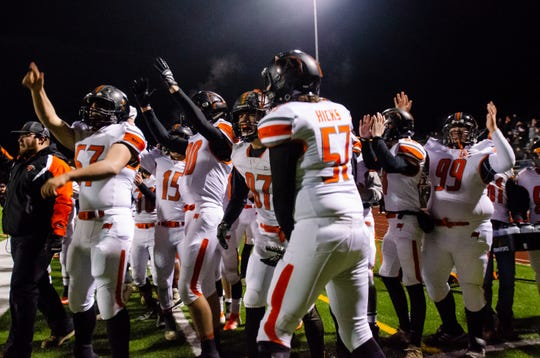 Almont celebrates their first touchdown in the MHSAA Division 5 district final against Marine City Friday, Nov. 8, 2019, at East China Stadium.