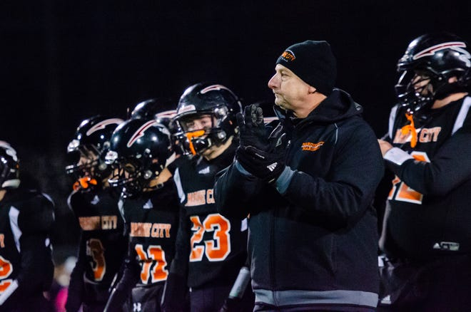 After being ejected in the first half of the game, Marine City head coach Ron Glodich returned to the field for the trophy presentation after Marine City fell 20-22 to Almont in the MHSAA Division 5 district final match Friday, Nov. 8, 2019, at East China Stadium.