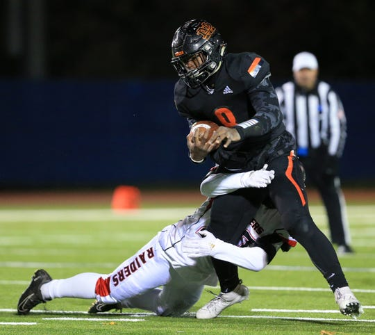 Marlboro's Elijah Williams is tackled by Port Jervis' Trey Wilkerson during the Section IX Football Championships in Middletown on November 8, 2019.