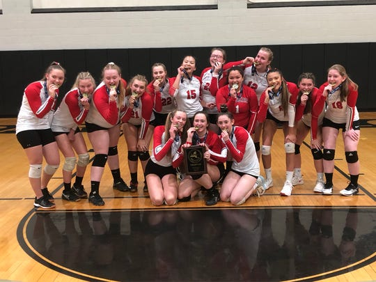 The Red Hook volleyball team poses with its plaque and medals after beating Port Jervis to win the Section 9 Class B championship on Saturday at Bard College.