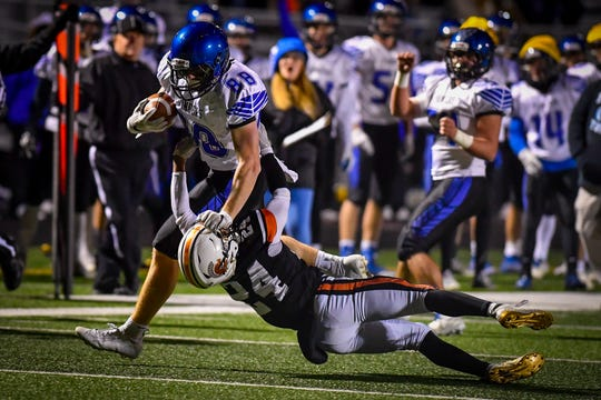 Beau Heyser of Lampeter-Strasburg stiff-arms York Suburban's Nate Banks out of his way duringt the District 3 Class 4-A quarterfinal, Friday, November 8, 2019. John A. Pavoncello photo