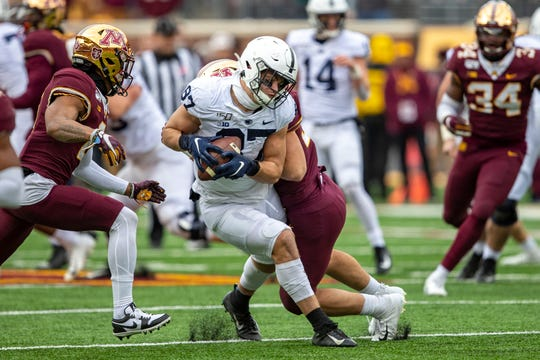 Nov 9, 2019; Minneapolis, MN, USA; Penn State Nittany Lions tight end Pat Freiermuth (87) catches a pass as Minnesota Golden Gophers linebacker Mariano Sori-Marin (55) makes a tackle in the first half at TCF Bank Stadium. Mandatory Credit: Jesse Johnson-USA TODAY Sports