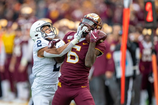 Nov 9, 2019; Minneapolis, MN, USA; Minnesota Golden Gophers wide receiver Tyler Johnson (6) catches a one handed touchdown pass over Penn State Nittany Lions cornerback Keaton Ellis (2) in the first half at TCF Bank Stadium. Mandatory Credit: Jesse Johnson-USA TODAY Sports