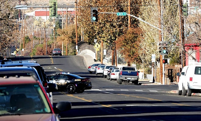 A Reno police patrol vehicle blocks traffic on Valley Road and Sixth Street following police activity in the area on Saturday, Nov. 9, 2019.