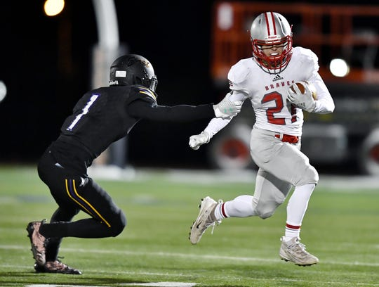 Canandaigua's Dominic Comella, right, breaks away from Eas's Levi Wright during the Section V Class A final played at Hobart & William Smith Colleges, Friday, Nov. 8, 2019. No. 5 seed Canandaigua claimed the Class A title with a 21-13 win over No. 2 seed East.