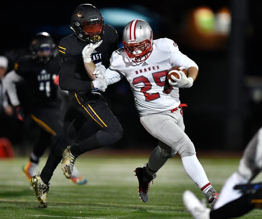 Canandaigua's Zachary Wantuck, right, escapes the grasp of East's Mike Maxwell during the first half of the Section V Class A championship game on Friday night.