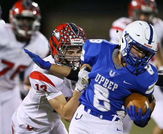 U-Prep's Damon Uribe tries to break away from East Nicolaus' Zack Scoggins in the 2nd quarter.