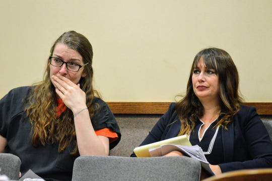Kendra Andersen-Schwegerl (left) sits with her defense lawyer Melissa Fanoe at Friday's sentencing hearing on Nov. 8, 2019.