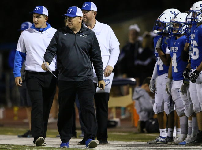 File photo - U-Prep football coach Darren Trueblood paces the sidelines during a game in 2019.