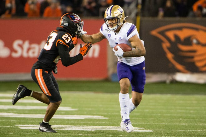 Nov 8, 2019; Corvallis, OR, USA; Washington Huskies tight end Hunter Bryant (1) stiff arms Oregon State Beavers defensive back Isaiah Dunn (23) after catching a pass during the second half at Reser Stadium. Mandatory Credit: Troy Wayrynen-USA TODAY Sports