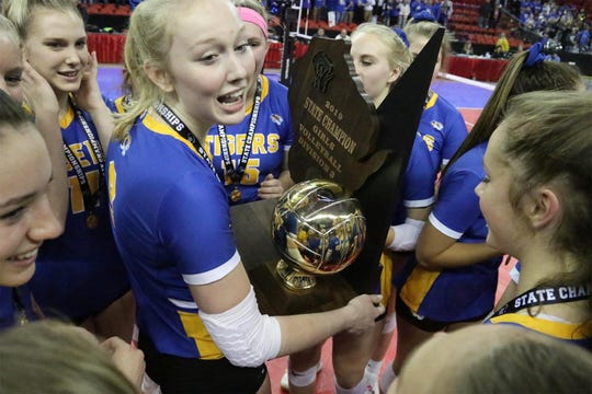 Emily Bruckschen (9, center) holds the WIAA State Volleyball Championship trophy at the WIAA State Volleyball Championships, Saturday, November 10, 2019, at the Resch Center in Green Bay, Wis. The team won in three games straight over Aquinas.