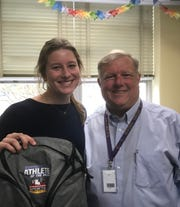 Byrd's Anna Clair Mackey stands with principal Jerry Badgley and her Times Athlete of the Week backpack.