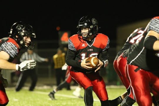 Thomas Scholten of Brandon Valley looks to hand the ball off during Friday's 11AAA semifinal game against Washington in Brandon.