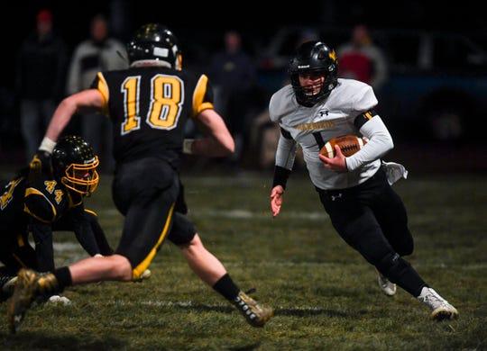 Wolsey-Wessington quarterback and linebacker Skylar Zomer (1) runs the ball during the semifinals against Colman-Egan on Friday, Nov. 8, 2019 at Colman-Egan High School.