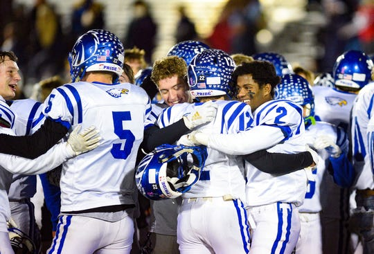 The Canton C-Hawks celebrate their win against the Tea Area Titans in the state class A semifinals on Friday, Nov. 8, in Tea.
