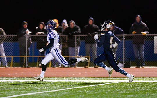 Kayden Verley of Canton runs toward the end zone with  Brayden Thompson of Tea Area on his tail during the state class A semifinals on Friday, Nov. 8, in Tea.