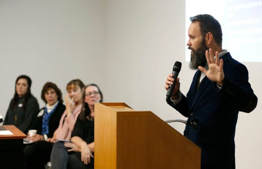 Adam Bodendieck with Community Partnership of the Ozarks leads a panel discussion about 'Dispelling Myths About Homelessness' at the Springfield Art Museum on Thursday, Nov. 7, 2019.